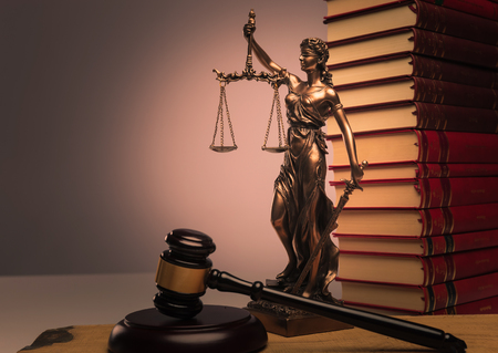 law books, justice statue and wooden gavel shot in studio