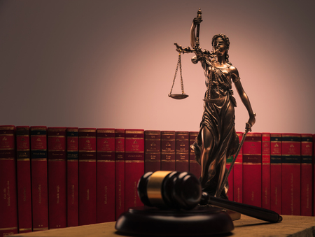 justice statue , law books and wooden gavel shot in studio