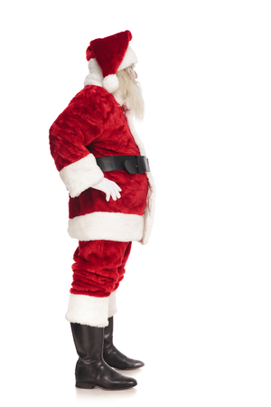 santa claus waiting in line while holding hips and standing on white background