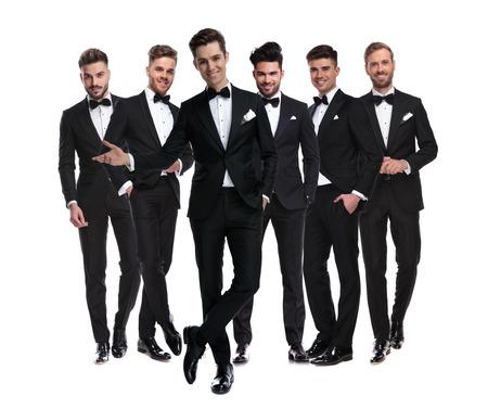 happy elegant man in tuxedo presenting his team, collage image on white background Reklamní fotografie
