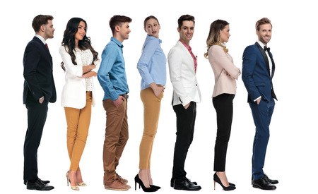 line of casual and elegant young people, on white background Stockfoto