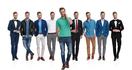 Casual guy walking and holding his hand on his neck while in front of a team of the same guy wearing different clothes on white background