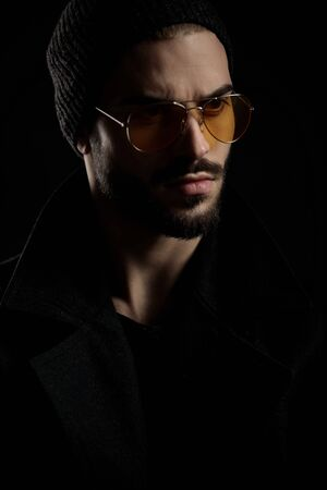 guy with beard looking furious at something while wearing sunglasses and black beanie
