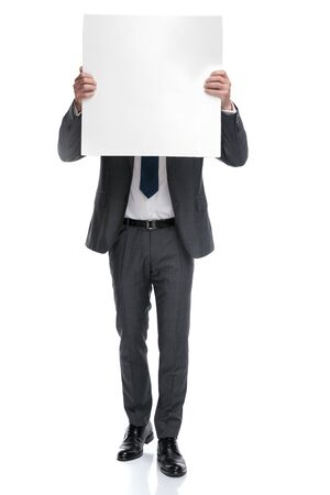 businessman covers his head with a blank board isolated on white background