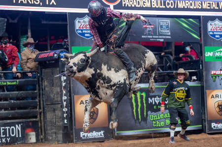 Rider flying high on a bull during the PBR event Unleash the Beast Editorial