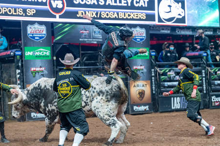 PBR rider being thrown from a bull during the Unleash the Beast event in Glendale, AZ Editorial