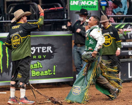 Keyshawn Whitehorse, professionall bull rider, celebrating his winning ride in Glendale, AZ