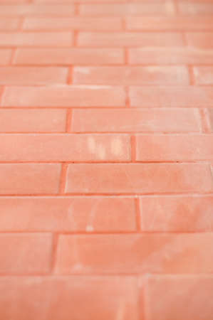 Wall that built with orange brick photo
