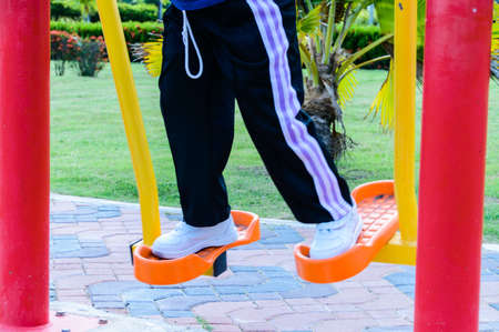 instructs: Exercise in the public park Editorial