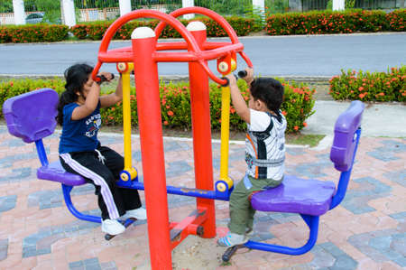 instructs: Boy and girl exercise in the public park