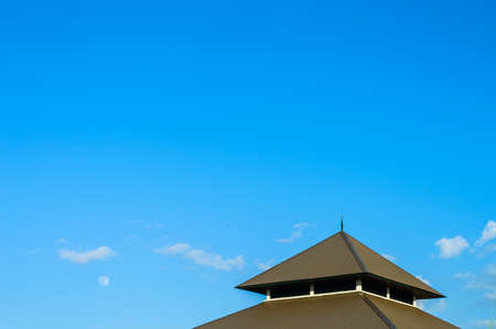 Gable roof and blue sky background photo