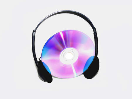 cdrom: Compact disk between a Headphone on white