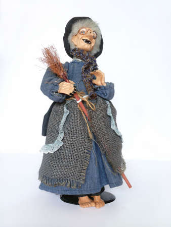 besom: Plastic Halloween old witch with broomstick and hat over white background