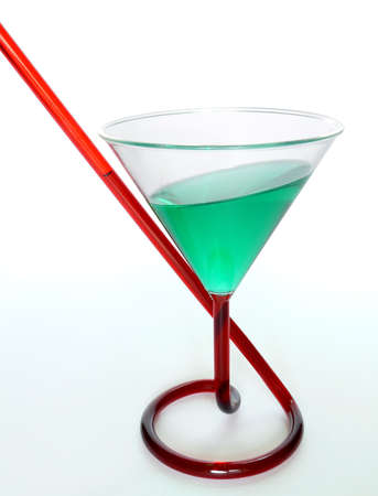 inclined: Drink in a glass with integrated straw in an interesting angle (wrong gravity) Stock Photo