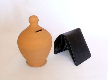 Old money box with a empty wallet symbolizing a stock market crisis photo