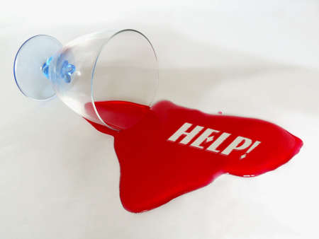 Drinking glass with spilled red liquid spelling HELP text message Stock Photo - 4009646