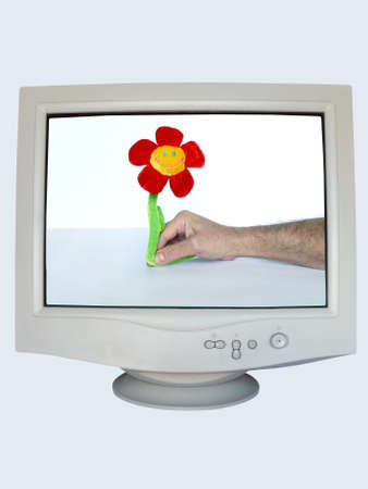 CRT Monitor with a hand giving away a fluffy flower: grant a smile series photo