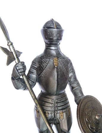 reproducing: Detail of a metal statuette reproducing a crusader with armour