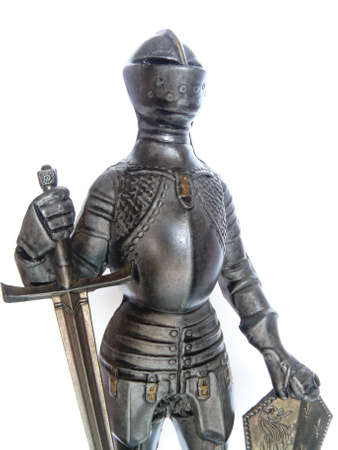 ancient warrior: Close-up of Suit of Armour with sword and shield