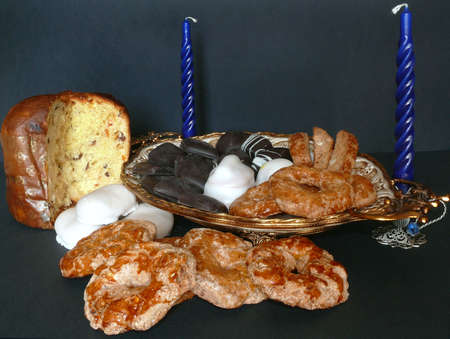 sweettooth: An italian Christmas table with panettone and pastries over black