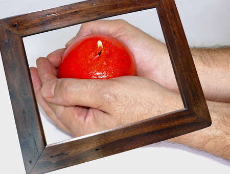 Wooden frame highlighting a couple of hands holding a red candle: grant a smile series photo