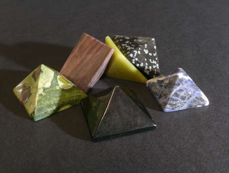 Pile of pyramidal gems over black