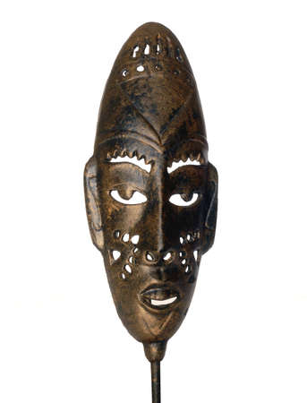 Details of a brassy African mask isolated on white Stock Photo - 4087795