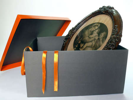 Open gift box with artistic wood frame inside, isolated over white photo