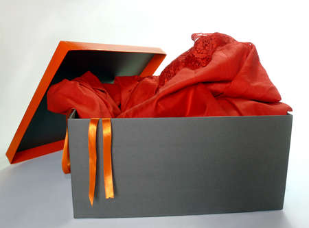 Red formal dress inside a gift box isolated over white Stock Photo - 4193863