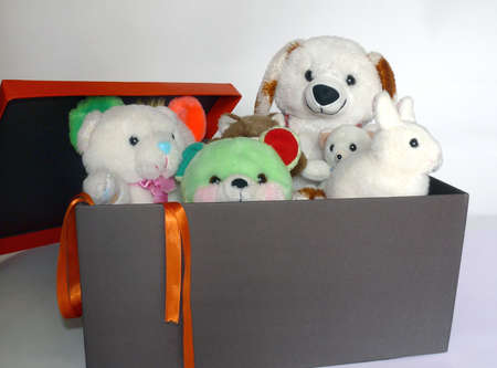 Group of teddy toys inside a black gift box Stock Photo - 4193869