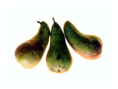Funny still-life with three isolated pears in backlighting photo