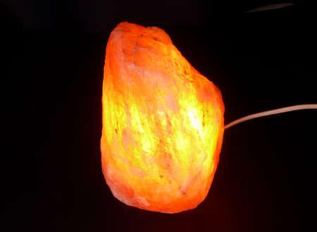 salt lamp: Ornamental salt stone lamp isolated on black Stock Photo