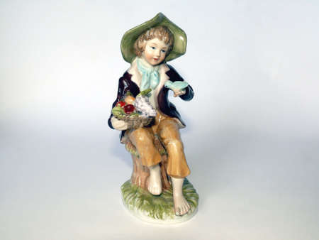 Ceramic figure of a shepherd boy with fruits  Stock Photo - 4269970