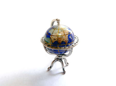 Small silver-plated earth globe isolated on white  photo