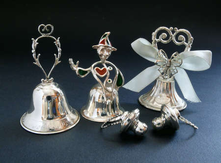 Wedding bells and pacifiers in silver-plate photo