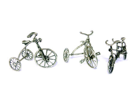 Ornamental bicycles in silver metal isolated on white