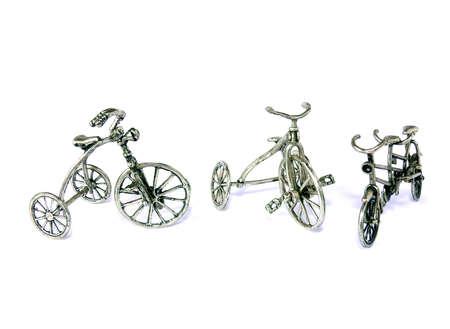 Sierdoeleinden fietsen in zilver metaal geïsoleerd op wit Stockfoto