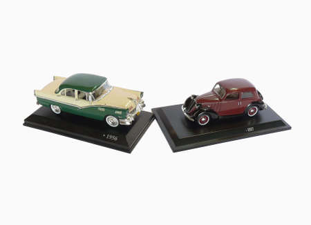 Two small-scale models of old cars photo