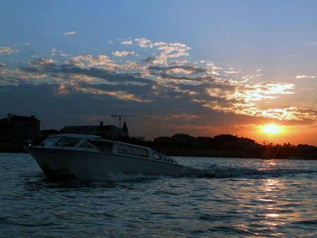 backlighting: View of Venice lagoon at setting sun Stock Photo