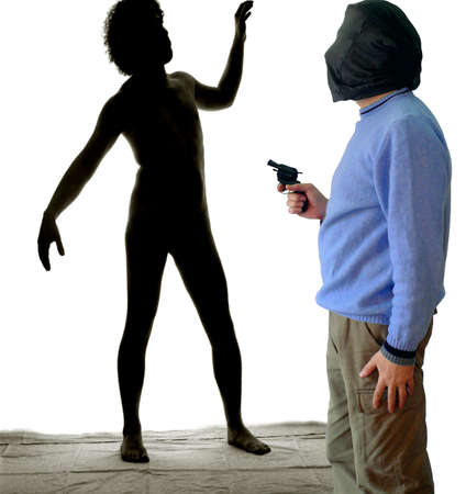 Youngster silhouette in background at gunpoint of armed guy wearing stocking Stock Photo - 4464783