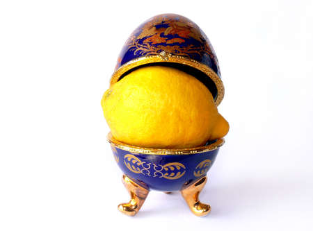 Blue enamelled ceramic casket (as Faberge eggs) with lemon inside photo