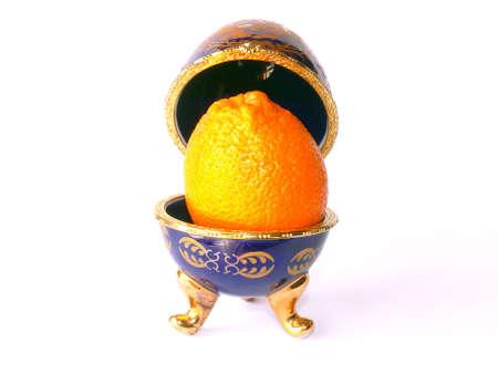 Blue enamelled ceramic casket (as Faberge eggs) with orange inside photo