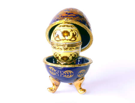 golden  gleam: Blue ceramic Easter Egg (as Faberge Eggs) with another yellow inside on white