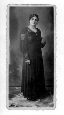 Antique photo of a lady at 1920 (dust & scratches were left to show age)