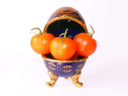 Blue enamelled ceramic casket (as Faberge eggs) with tomatoes inside photo