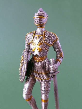 Details of Suit of Armour with sword and shield on green Stock Photo - 4490624