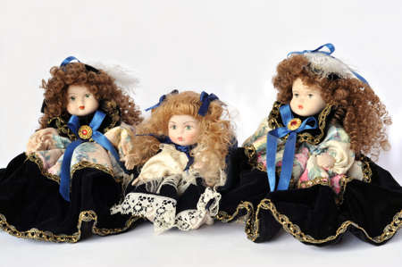 Ornamental ceramic dolls over white photo