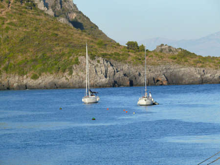 Two sailboats anchored in a peaceful bay off Italian coast Stock Photo - 4560342