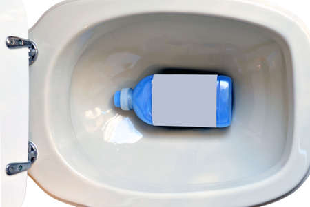 A toilet viewed from above with a detergent bottle inside photo