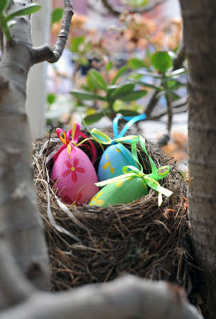 Decorative Easter eggs in a grass nest